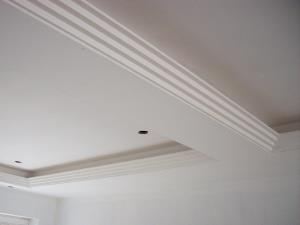 Photo - Stepped contemporary plaster cornice uplighter with a trough for ambient strip lighting